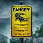 Crawl movie poster with Danger! sign with alligator warning
