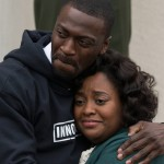Aldis Hodge holds Sherri Shepherd in the movie Brian Banks