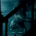 A creepy creature crawling downstairs glimpsed from the shadows in the movie Scary Stories to Tell in the Dark