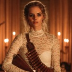 Samara Weaving in a wedding dress holding a gun in the movie Ready or Not