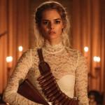 Samara Weaving in a wedding dress holding a gun in the movie Ready or Not