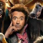 Robert Downey Jr. sits among animals in the poster for the movie Dolittle