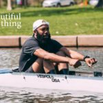 A man rowing sitting in his boat as part of a crew team from the documentary A Most Beautiful Thing