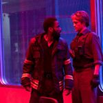 John David Washington and Robert Pattinson basked in red light stare each other down in Christopher Nolan's Tenet