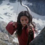 Yifei Liu holds poised to fire an arrow in the movie Mulan